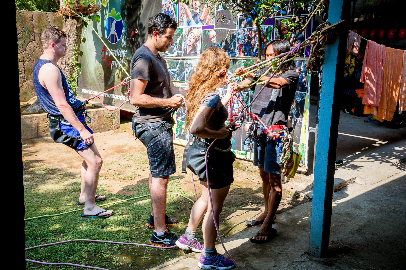 Learning how to set up our rappel ropes at the Adventure & Spirit offices in Bali