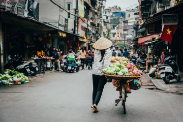 A fruit vendor walking the streets of Hanoi during our street food tour